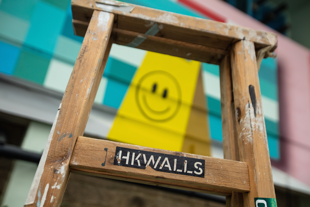 A close up of the smiley face on Low Bros HKwalls mural in Hong Kong
